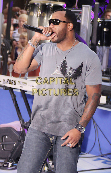 "FLO RIDER.Performs On NBC's ""Today"" Show at Rockefeller Center, New York, NY, USA, .14th August 2009..half length music concert gig live singing microphone grey gray t-shirt silver necklace tattoo watch sunglasses flo rida Tramar Dillard .CAP/ADM/AC.©Alex Cole/AdMedia/Capital Pictures"