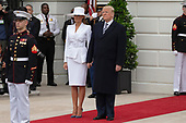 United States President Donald J. Trump and first lady of the United States Melania Trump emerge from the White House as the await the arrival of French President Emmanuel Macron and first lady of France Brigette Macron on the South Lawn of the White House during the French State Visit to the United States on April 24, 2018 in Washington, DC. Credit: Alex Edelman / Pool via CNP