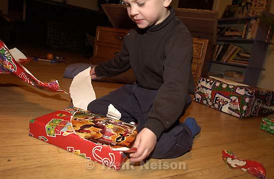 Noah Nelson and Nathaniel Nelson opening presents on Christmas. 12.25.2001, 7:54:59 AM<br />