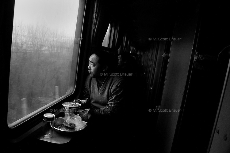 People ride a sleeper train in Shandong Province, China.