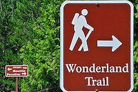 Road and hiking trail signs for either Seattle, Paradise and Wonderland Trail in Mt Rainier National Park, WA State