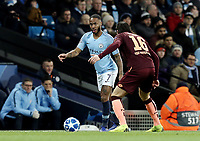 Manchester City's Raheem Sterling under pressure from 1899 Hoffenheim's Nico Schulz<br /> <br /> Photographer Rich Linley/CameraSport<br /> <br /> UEFA Champions League Group F - Manchester City v TSG 1899 Hoffenheim - Wednesday 12th December 2018 - The Etihad - Manchester<br />  <br /> World Copyright © 2018 CameraSport. All rights reserved. 43 Linden Ave. Countesthorpe. Leicester. England. LE8 5PG - Tel: +44 (0) 116 277 4147 - admin@camerasport.com - www.camerasport.com