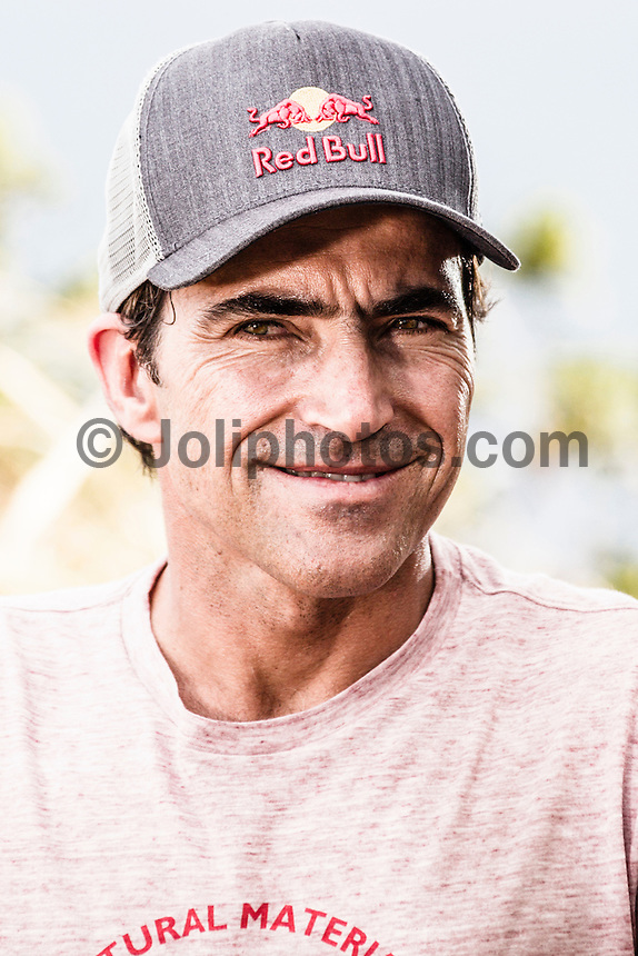 """Pe'ahi, Maui, HAWAII - (December 8, 2012) Carlos Burle (BRA). - Invitees and alternates of the RED BULL JAWS, Paddle at Pe'ahi big wave event gathered high upon the Pe'ahi Overlook in a private blessing that officially opened the three-month holding period for this one-day event. A spiritual ceremony, deeply rooted in Maui's history and Polynesian culture, took place under unusually clear and hot skies, with barely a breath of wind.  . The RED BULL JAWS, Paddle at Pe'ahi presented by Casio G'z One is a one-day big wave paddle-in surfing event that will be held on a single day between December 7, 2012 and March 15, 2013, when wave face heights reach between 30 and 50 feet, and with no assistance from motorized personal watercraft..Led by Kupuna Leslie Kuloloio and Kumu Pulama Collier, surfers listened to the ancestral story of Pe'ahi - known to Hawaiians as Ke Kai 'o Waitakulu, or """"the teary eye place"""". Each was presented with a special kihei, or cloak, in recognition of their expertise in big wave riding..  Photo: joliphotos.com"""