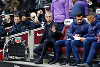 23rd November 2019; London Stadium, London, England; English Premier League Football, West Ham United versus Tottenham Hotspur; Tottenham Hotspur Manager Jose Mourinho looking on from the dugout before kick off - Strictly Editorial Use Only. No use with unauthorized audio, video, data, fixture lists, club/league logos or 'live' services. Online in-match use limited to 120 images, no video emulation. No use in betting, games or single club/league/player publications