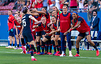 FRISCO, TX - MARCH 11: Emily Sonnett #14, Ali Krieger #11, Ashlyn Harris #18 and Jess McDonald #22 of the United States and the rest of the bench celebrate during a game between Japan and USWNT at Toyota Stadium on March 11, 2020 in Frisco, Texas.