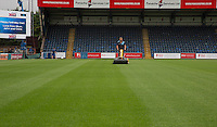 General view of the Groundsman at work on the pitch at Wycombe Wanderers Stadium, Adams Park, High Wycombe, Bucks, England on 12 July 2015. Photo by Andy Rowland.