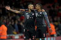 Arturo Vidal of Bayern Munich (left) celebrates with Douglas Costa of Bayern Munich after scoring their 5th goal and his 2nd to make it 1-4 during the UEFA Champions League round of 16 match between Arsenal and Bayern Munich at the Emirates Stadium, London, England on 7 March 2017. Photo by Alan  Stanford / PRiME Media Images.