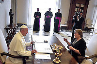 Pope Francis and Chile's President Michelle Bachelet laugh during a private audience on June 5, 2015 at the Vatican.