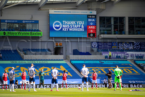 20th June 2020, American Express Stadium, Brighton, Sussex, England; Premier League football, Brighton versus Arsenal ;  Players and officials take part in a minute of silence to commemorate the victims of the COVID-19 pandemic prior to the Premier League match