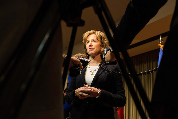 "April 16, 2014. Durham, North Carolina.<br />  Senator Kay Hagan, center, spoke with the press after an event to award a posthumous Bronze Star. Hagan has been largely absent from the campaign trail even as several Republican challengers have mounted campaigns to defeat her in this year's election.<br />  Kay Hagan (D),  US Senator from North Carolina, attended an event to honor the military service of Donald ""Buddy"" Moore, Hagan awarded Moore's widow Wanda a posthumous Bronze Star, as well as several other medals, for his service in World War II."
