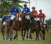 NWA Democrat-Gazette/ANDY SHUPE<br /> John Hand (from left) directs the ball to the goal Saturday, Sept. 8, 2018, ahead of Greg Summers, Elliot Merck and Josh Shelton during the 29th annual Polo in the Ozarks at the Buell Farm in Goshen. This event features a polo match, games, vendors, music and food to benefit Life Styles Inc.