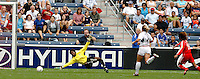 China forward Han Duan (10) beats USA defender Cat Whitehill (4) and USA goalkeeper Briana Scurry (1) to score the game's first goal.  The U.S. Women's National Team defeated China 4-1 at Toyota Park in Bridgeview, IL on August 28, 2006.