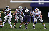Blocking for Ohio State Buckeyes quarterback Braxton Miller (5) are Ohio State Buckeyes offensive linesman Andrew Norwell (78) and Ohio State Buckeyes offensive linesman Jack Mewhort (74) during the first half of the NCAA football game between Ohio State and Northwestern at Ryan Field in Evanston, Illinois on Saturday, October 5, 2013. Final score: Ohio State 40, Northwestern 30. (Columbus Dispatch photo by Jonathan Quilter)