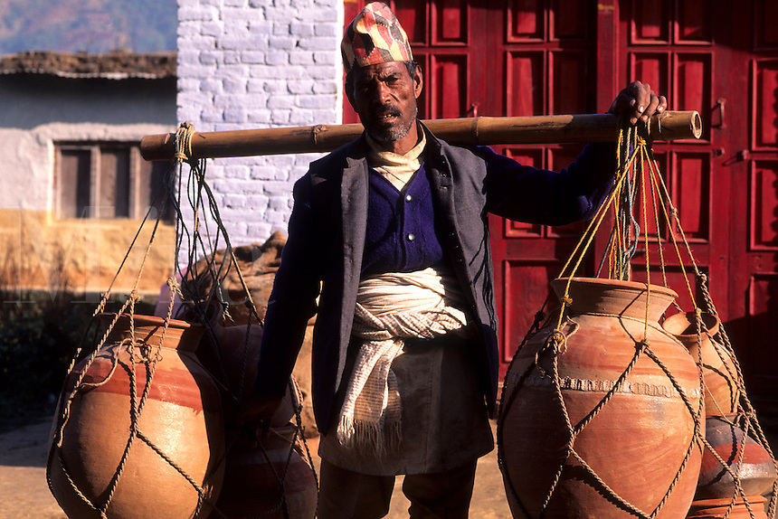 Rugged man with large load of pottery on his back near Mt Everest in remote country of Nepal