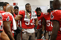 TAMPA, FL - NOVEMBER 11: Defensive Tackle Gerald McCoy #93 of the Tampa Bay Buccaneers addresses the defense in the locker room during the game against the Miami Dolphins at Raymond James Stadium on November 11, 2013, in Tampa, Florida. The Buccaneers won 22-19. (photo by Matt May/Tampa Bay Buccaneers)