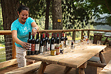 USA, Oregon, Wild and Scenic Rogue River in the Medford District, wine tasting with Liz Wan at the Paradise Lodge