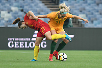 26 November 2017, Melbourne - XU YANLU (21) of China PR and ELLIE CARPENTER (21) of Australia fight for the ball during an international friendly match between the Australian Matildas and China PR at GMHBA Stadium in Geelong, Australia.. Australia won 5-1. Photo Sydney Low