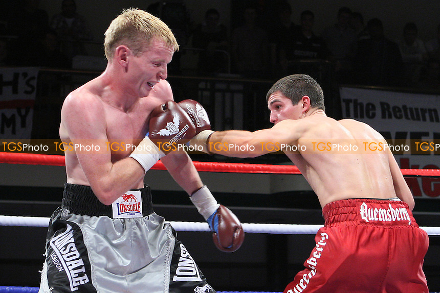 Billy Morgan (claret shorts) defeats Dan Carr in a Lightweight boxing contest at York Hall, Bethnal Green, promoted by Frank Warren - 23/10/10 - MANDATORY CREDIT: Gavin Ellis/TGSPHOTO - Self billing applies where appropriate - Tel: 0845 094 6026