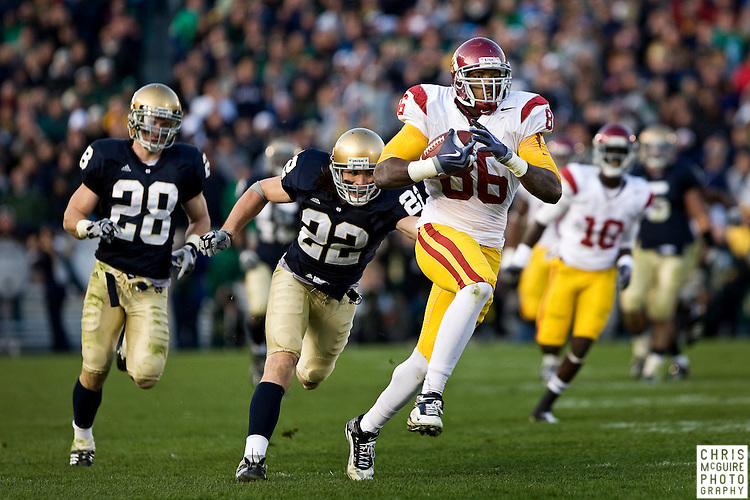 10/17/09 - South Bend, IN:  USC tight end Anthony McCoy takes a pass from quarterback Matt Barkley 60 yards in the third quarter against Notre Dame during their game at Notre Dame Stadium on Saturday.  USC won the game 34-27 to extend its win streak over Notre Dame to 8 games.  Photo by Christopher McGuire.
