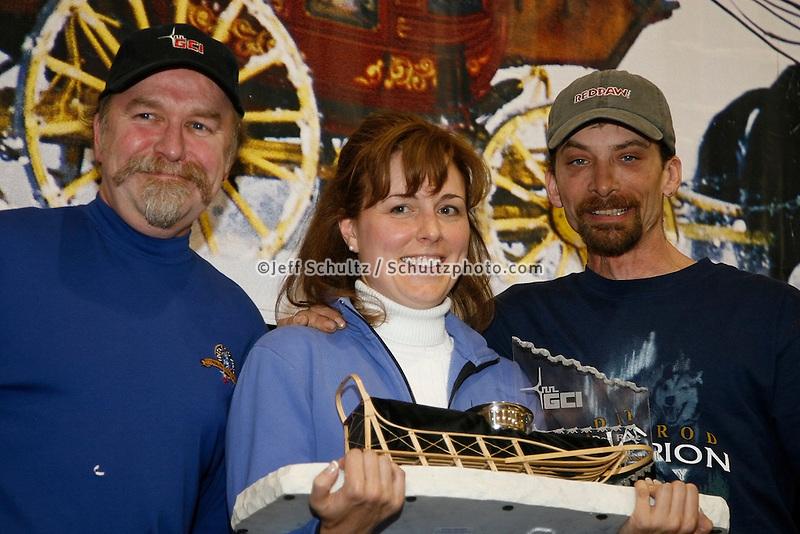 Lance Mackey recieves the GCI half-way award from Gary Samuelson and Maureen Moore at the Nome awards banquet.