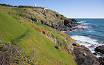Lighthouse headland and coastal scenery with cliffs and ocean at Lizard Point, Cornwall, England