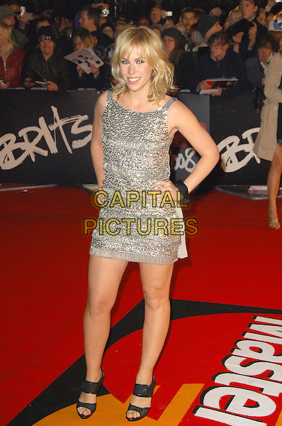 NATASHA BEDINGFIELD.The Brit Awards, Earls Court, London, England..February 20th, 2008.brit full length silver hands on hip sequins sequined beads beaded dress sparkly .CAP/CAS.©Bob Cass/Capital Pictures.