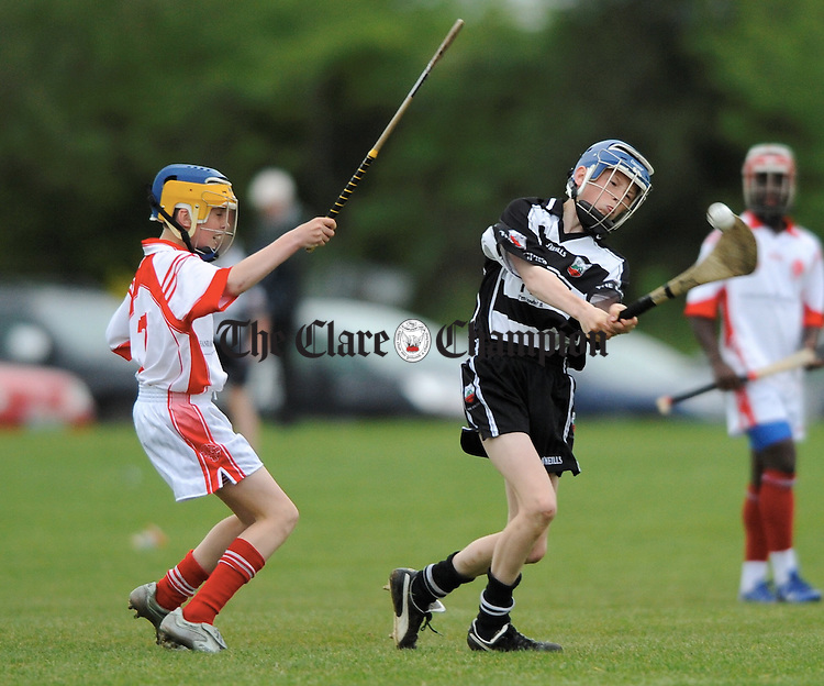 Darragh Walsh of Eire Og moves to block Bobby Duggan of Clarecastle during their U-14A hurling semi final at Gurteen. Photograph by John Kelly.