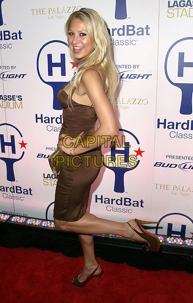ANNA KOURNIKOVA.The HardBat Open All-Star Table Tennis Tournament holds its MVP afterparty at the Palazzo Resort Hotel and Casino, Las Vegas, Nevada, USA..June 27th, 2009.full length brown dress hand on hip gold clutch bag black shoes leg up.CAP/ADM/MJT.© MJT/AdMedia/Capital Pictures.