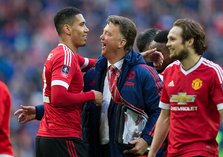 Manchester United manager Louis van Gaal celebrates with Chris Smalling at full time<br /> <br /> Photographer Craig Mercer/CameraSport<br /> <br /> Football - The FA Cup Semi Final - Everton v Manchester United - Saturday 23rd April 2016 - Wembley - London<br /> <br /> &copy; CameraSport - 43 Linden Ave. Countesthorpe. Leicester. England. LE8 5PG - Tel: +44 (0) 116 277 4147 - admin@camerasport.com - www.camerasport.com