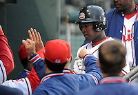April 3, 2008: Yamaico Navarro (12) of the Greenville Drive, Class A affiliate of the Boston Red Sox, is congratulated after scoring the season's first run during the season opener against the Kannapolis Intimidators at Fluor Field at the West End in Greenville, S.C. Photo by:  Tom Priddy/Four Seam Images