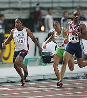 Mark Lewis-Francis(594) ran 10.13sec. and J-Mee Samuels(1137) ran 10.29sec. in the second round of the 100m on Saturday, August 25, 2007. Photo by Errol Anderson,The Sporting Image.