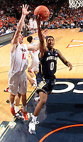 Notre Dame guard Eric Atkins shoots next to Virginia guard Joe Harris (12) during the game Saturday, February 22, 2014,  in Charlottesville, VA. Virginia won 70-49.