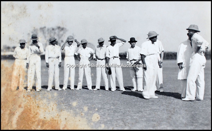 BNPS.co.uk (01202 558833)<br /> Pic: Bishop&MillerAuctioneers/BNPS<br /> <br /> The Delhi & District XI in the field.<br /> <br /> A fascinating album of photographs showing the first England cricket tour of India and the last for controversial 'Bodyline' captain Douglas Jardine has been discovered.<br /> <br /> The rare black and white images show the England star leading the national side at the new cricket ground in Delhi that the colonial British had built in 1933 - the same year as the brutal Ashes series.<br /> <br /> Jardine is featured in many photos as is the Viceroy of India. The album is being sold by auctioneers Bishop and Miller of Suffolk.