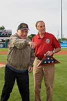 "World War II veteran, and Batavia Muckdogs fan, Roland R. ""Cappy"" Cappiello throws out the ceremonial first pitch as Congressman Chris Collins looks on before a NY-Penn League game against the Auburn Doubledays on June 14, 2019 at Dwyer Stadium in Batavia, New York.  Batavia defeated 2-0.  (Mike Janes/Four Seam Images)"