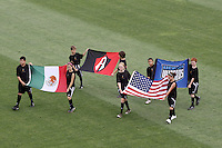 The flags of both clubs and countries are carried onto the pitch..Kansas City Wizards and Atlas (Mexico) played to a 0-0 tie at Robert R Hermann Stadium, on the campus of Saint Louis University, St Louis , Missouri.