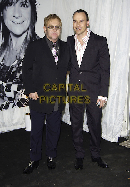 ELTON JOHN & DAVID FURNISH.Women to Women: Positively Speaking Book Launch Gala,.The Orangery, Kensington Palace, London, .December 2nd 2004..full length suit pinstripe.Ref: PL.www.capitalpictures.com.sales@capitalpictures.com.©Capital Pictures.