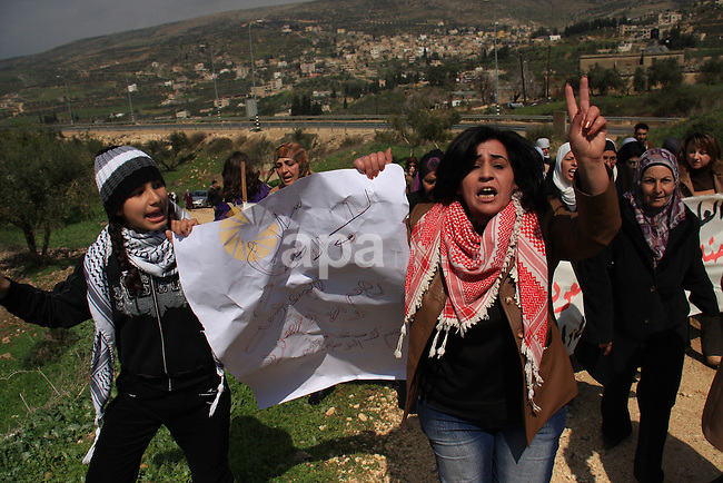 Palestinian women shout slogans during women's demonstration in the West Bank village of Burin, near Nablus, Tuesday ,March 8, 2011. The protest was organized by Palestinian women to mark the International Women's Day and against the expansion of Israeli settlements. Photo by Wagdi Eshtayah