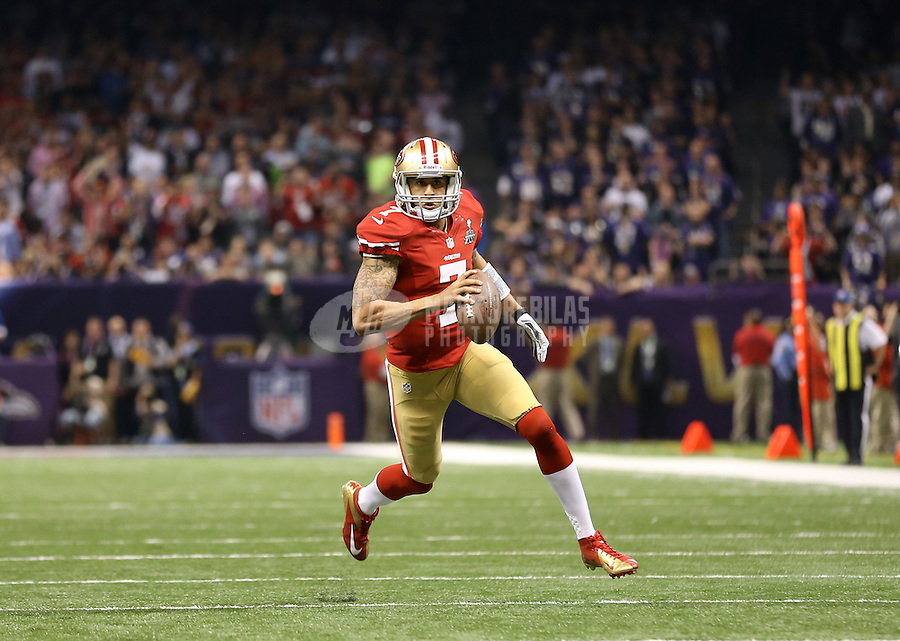 Feb 3, 2013; New Orleans, LA, USA; San Francisco 49ers quarterback Colin Kaepernick (7) scores a touchdown against the Baltimore Ravens in the fourth quarter in Super Bowl XLVII at the Mercedes-Benz Superdome. Mandatory Credit: Mark J. Rebilas-
