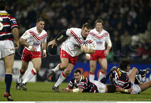 DARREN BRITT takes on the Roosters defence. ST HELENS 0 v Sydney Roosters 38, World Club Challenge 2003, Reebok Stadium, Bolton 030214 Photo:Neil Tingle/Action Plus...rugby league.player superleague