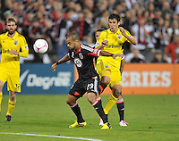D.C. United midfielder Maicon Santos (29) shields the ball against Colubmus Crew midfielder Milovan Mirosevic (10) D.C. United defeated The Columbus Crew 3-2 at RFK Stadium, Saturday October 20, 2012.