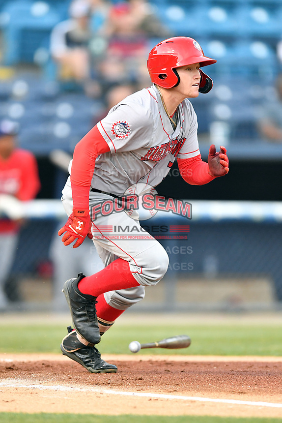 Hagerstown Suns left fielder Justin Connell (7) runs to first base during a game against the Asheville Tourists at McCormick Field on April 30, 2019 in Asheville, North Carolina. The Tourists defeated the Suns 5-4. (Tony Farlow/Four Seam Images)