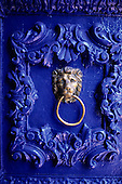 Cusco, Peru. Ornate blue painted door with lion knocker; Hotel Garcilaso.