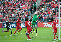 August 21 2010 Toronto FC goalkeeper Stefan Frei #24 has a ball slip through his hands during a game between DC United and Toronto FC at BMO Field in Toronto..DC United won 1-0.