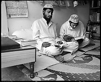 Deoband, India, March 2002.Islamic students in a bookshop.