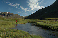 Jente fisker med flue i liten elv på Vest-Grønland ---- Girl angling in small river in West-Greenland