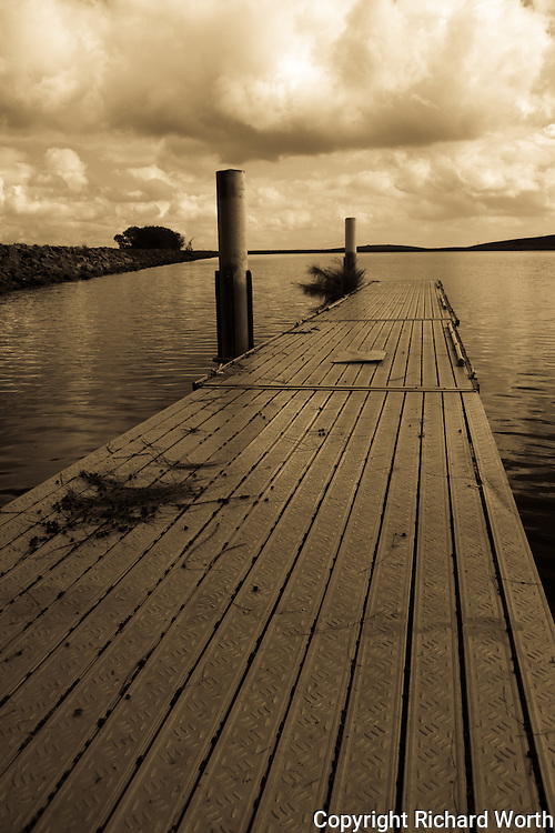 The pier at Bethany Reservoir the boat launching area bobs with the rippling water.