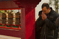 Buddhist devotees turning the prayer wheels at a monastery in Sikkim, India