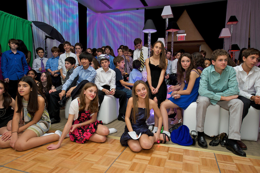 Kids watching the video montage at a Mitzvah celebration