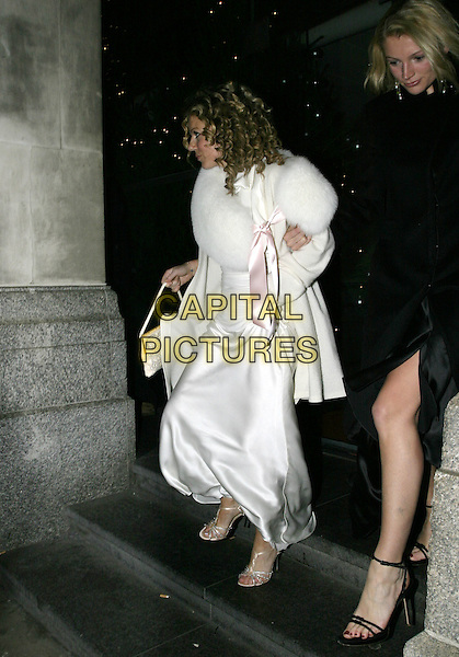 GERI HALLIWELL.At La Dolce Vita Ball in association with UNICEF,.Old Billingsgate, London, December 13th 2004..full length white satin dress pink ribbon bow fur wrap cape shawl.Ref: AH.www.capitalpictures.com.sales@capitalpictures.com.©Capital Pictures.