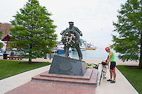 Statue of Captain at the Helm at Navy Pier and man with bicycle. Chicago Illinois USA